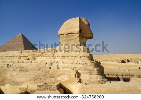 Egyptian Sphinx, the Egyptian pyramids, historical sites, ancient monuments of mankind. Ruins of antiquity, travel and tourism. Archaeological excavations.  Ancient civilization of the pharaohs. - stock photo