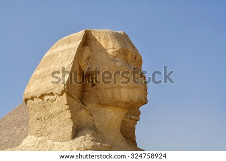 Egyptian Sphinx, the head of the Sphinx, the Egyptian pyramids and historical places. The ruins of antiquity, travel and tourism. Archaeological excavations. The ancient civilization of the pharaohs. - stock photo