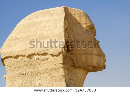 Egyptian Sphinx, the head, the Egyptian pyramids and historical places. The ruins of antiquity, travel and tourism. The archaeological excavations. The ancient civilization of the pharaohs. - stock photo