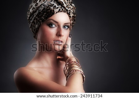 Egyptian Style Woman. Golden Jewels. Egypt Styled Makeup. Gold Light. Jewellery