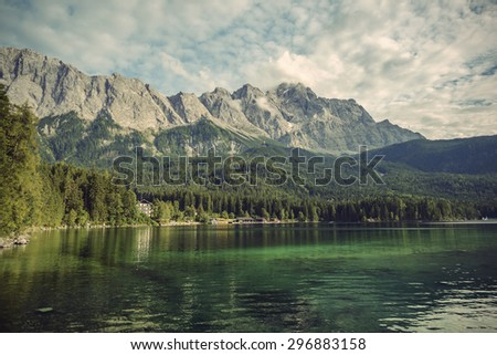 Eibsee lake and Zugspitze, at 2,962 meters, is the highest peak of the Wetterstein Mountains as well as the highest mountain in Germany, Europe, Vintage filtered style - stock photo