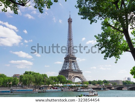 eiffel tour over Seine river with tree, Paris,  France - stock photo