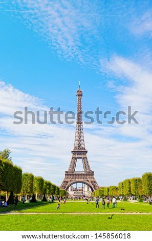 Eiffel Tower against the blue sky and clouds. Paris. France.