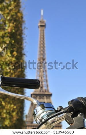 Eiffel tower and bicycle handlebars in Paris - stock photo