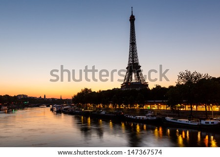 Eiffel Tower and d'Iena Bridge at Dawn, Paris, France - stock photo
