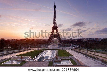 Eiffel Tower and fountain at Jardins du Trocadero at sunset, Paris, France - stock photo