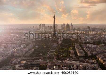 Eiffel Tower and Paris cityscape from above in sunset sunlight, France