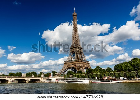 Eiffel Tower and Seine River with White Clouds in Background, Paris, France - stock photo