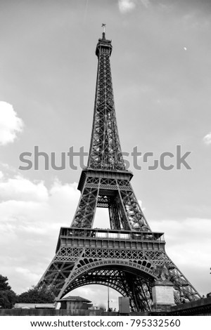 Eiffel Tower at sunset in Paris, France. Romantic travel background. Eiffel tower is traditional symbol of paris and love.