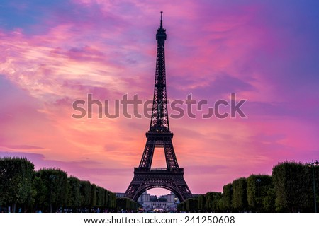 Eiffel Tower at sunset is the most visited monument in France and the most famous symbol of Paris, - stock photo