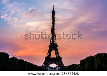 Eiffel Tower at sunset is the most visited monument in Paris - stock photo