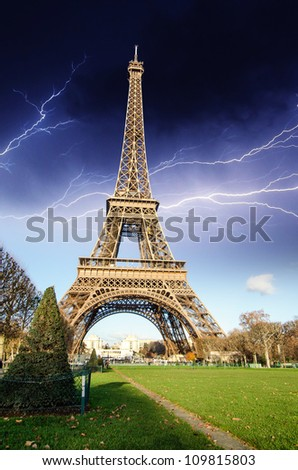 Eiffel Tower from Champs de Mars against dramatic Sky