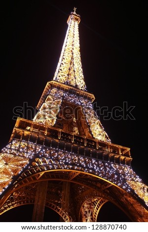 Eiffel tower in Paris by night. - stock photo