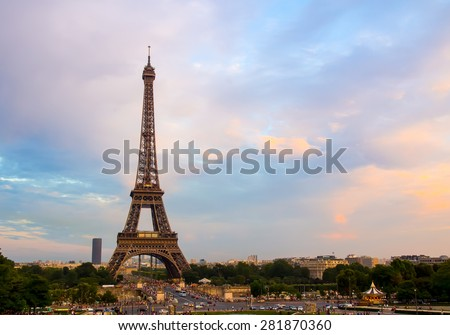 Eiffel Tower in Paris, France. City landmarks with sunset sky. - stock photo