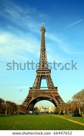 Eiffel tower in Paris, France: Eiffel tower shot from Champ de Mars on very cold winter day - Trocadero can be seen at distance under tower.