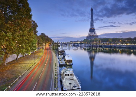 Eiffel tower in Paris, France. Image of Eiffel tower with the reflection in the Seine river. - stock photo