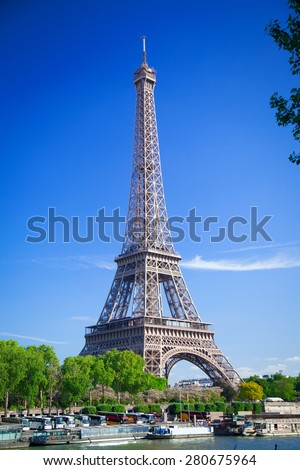 Eiffel Tower in Paris on a sunny summer day. - stock photo