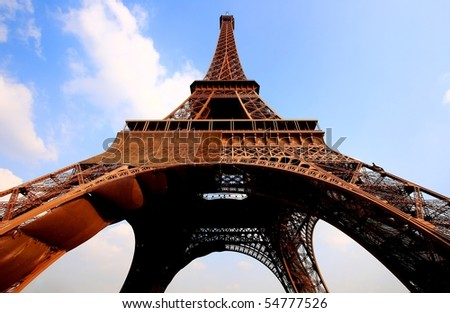 Eiffel tower in Paris with gorgeous colors and wide angle central perspective. - stock photo