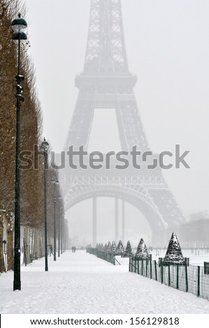 Eiffel Tower in the fog - stock photo