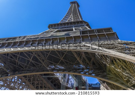 Eiffel Tower (La Tour Eiffel) located on Champ de Mars in Paris, named after engineer Gustave Eiffel. Eiffel Tower is tallest structure in Paris and most-visited monument in the world. France.
