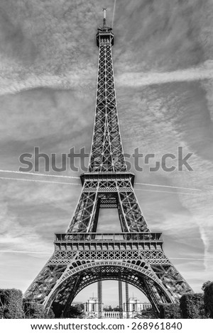 Eiffel Tower (La Tour Eiffel) located on Champ de Mars in Paris, named after engineer Gustave Eiffel. Eiffel Tower is tallest structure in Paris and most visited monument in world. Black and white. - stock photo