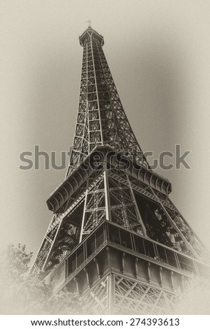 Eiffel Tower (La Tour Eiffel) located on Champ de Mars, named after engineer Gustave Eiffel. Eiffel Tower is tallest structure in Paris and most-visited monument in the world. France. Antique vintage.