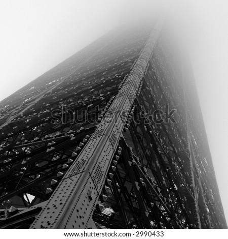 Eiffel Tower, looking up in the mist - stock photo