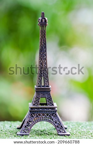 Eiffel tower miniature  in Paris on nature background - stock photo