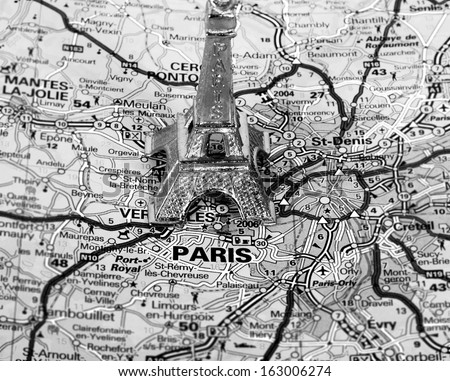 Eiffel Tower on a map of Paris, short focus,  black and white version. - stock photo