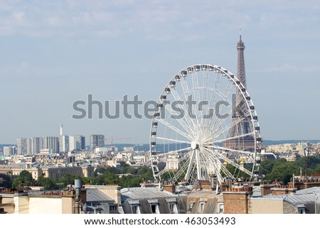Eiffel tower on a sunny summer day, with the rooftops of Paris