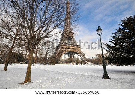 Eiffel Tower on a sunny winter day - stock photo