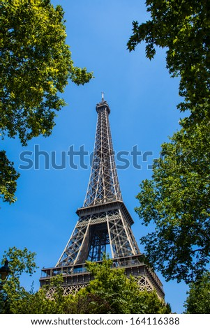 Eiffel tower on bright summer day - stock photo
