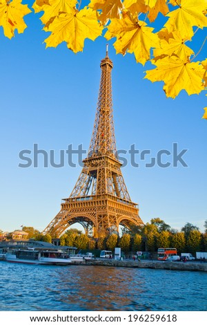 Eiffel Tower over Seina river in autumn day, Paris,  France - stock photo