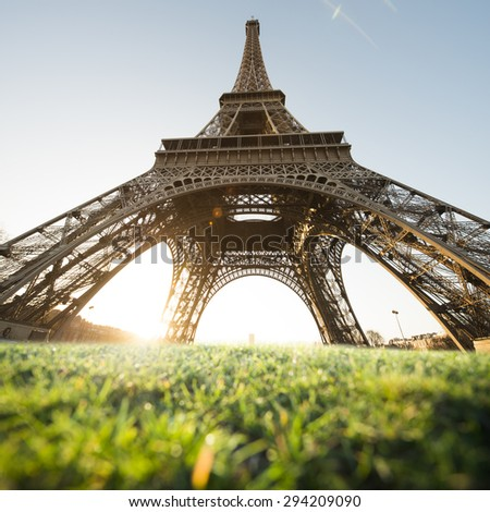 Eiffel Tower, Paris, France. Top Europe Destination. Intentional blur of grass in the foreground - stock photo
