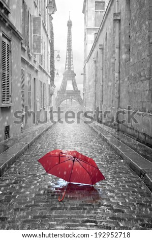 Eiffel tower view from the street of Paris. Black and white photo with red element.  - stock photo