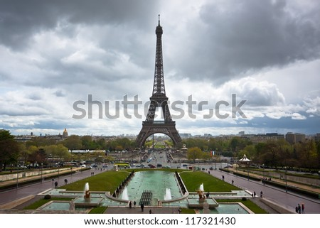 Eiffel tower with dramatic sky, France, Paris - stock photo