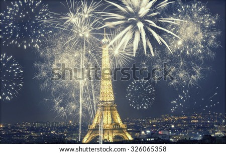Eiffel tower with fireworks, celebration of the New Year in Paris, France - retro styled photo  - stock photo