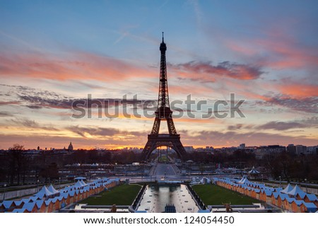 Eiffel Tower with red clouds and blue sky on the sunrise - stock photo