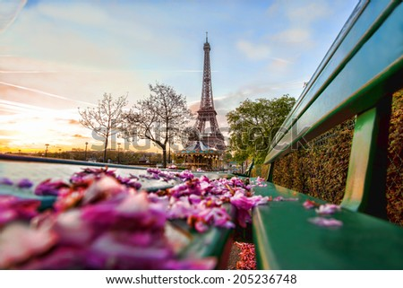 Eiffel Tower with spring leaves in Paris, France - stock photo