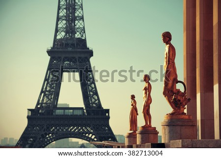 Eiffel Tower with statue as the famous city landmark in Paris - stock photo