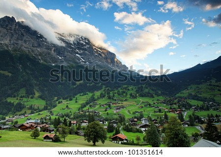 Eiger Peak (3970m) and Grindelwald Village, Berner Oberland, Switzerland - UNESCO Heritage - stock photo