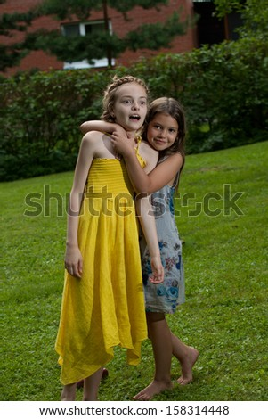 Eight and nine yeas old girls playng on the fresh air - stock photo