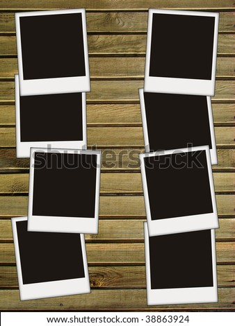 eight blank photoson wooden background