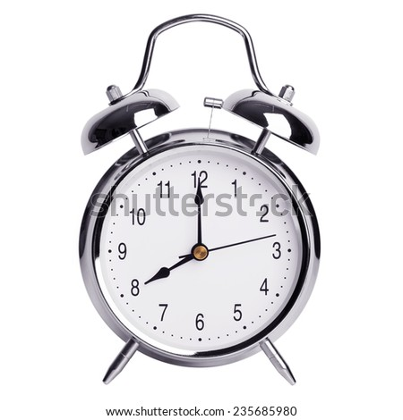 Eight hours on a round alarm clock - stock photo