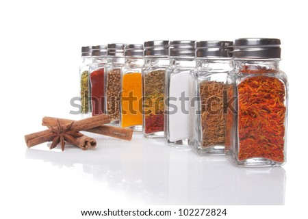 Eight jars of spices isolated over white