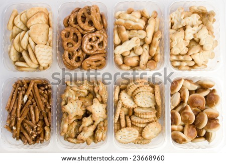 eight kinds of crackers on white ground