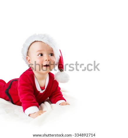 eight month old baby isolated on white background in santa costume