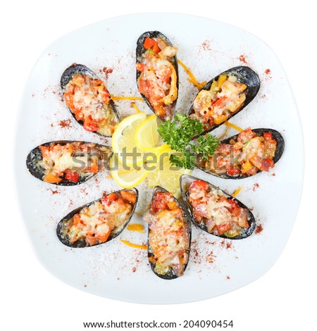Eight mussel shells with vegetables and cheese on a white dish isolated on a white background. Top view. - stock photo