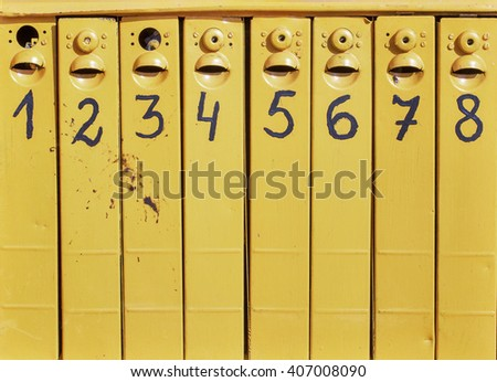 eight old mail boxes from one to eight - stock photo