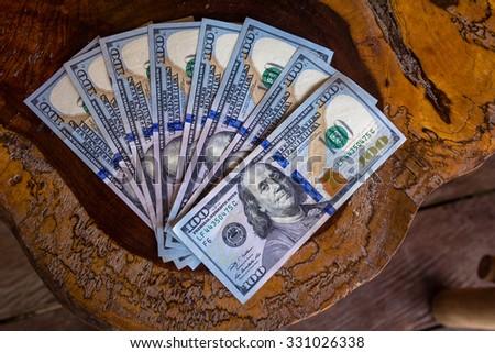 Eight one hundred dollar bills/ Money Dollars/ Eight one hundred dollar American  bills sits on a table. - stock photo